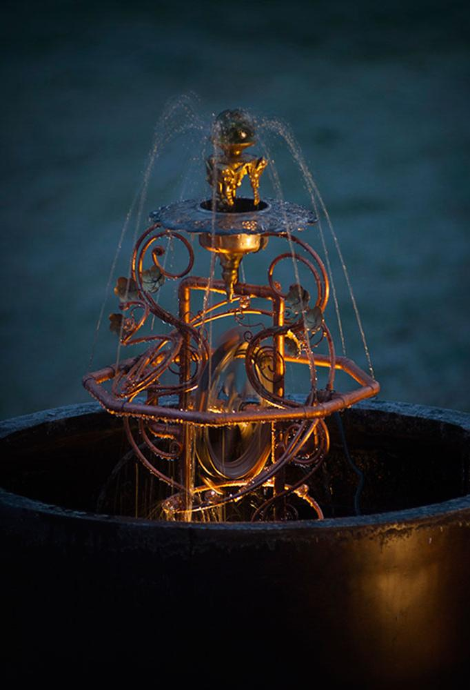 Made from copper tubing, a water wheel and repurposed brass and silver.