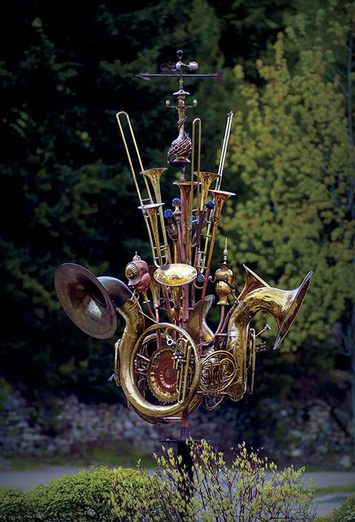 Musical instrument sculpture, Nelson, BC  This musical instrument wind sculpture was made from upcycled musical instruments, copper and steel tubing and a collection of brass, silver and glass collected objects.  It is currently on lease to the city of Nelson.